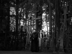 Priest and Crosses