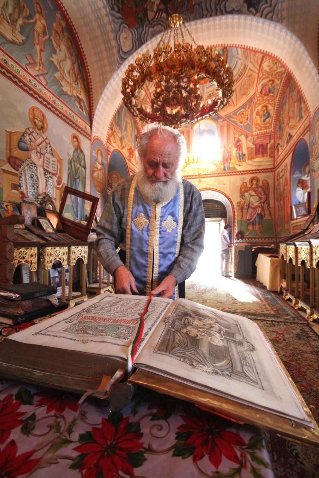 Archim. John of St. Theodore Tyron Monastery in Pravec showing an old Gospel