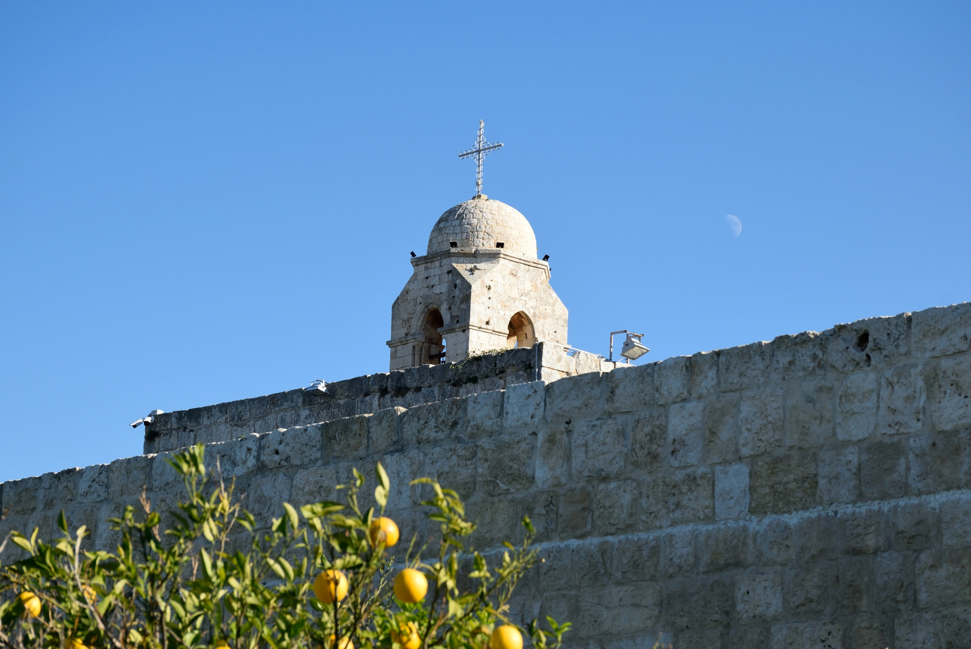 Dome of the Balamand monastery and the moon during the day