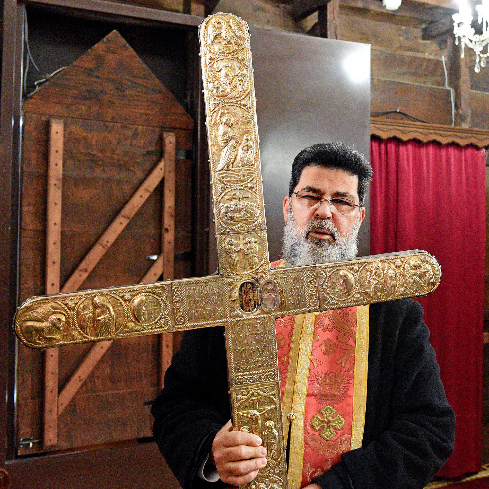 Fr Neophytos from Omodos holding piece of Holy Cross and rope